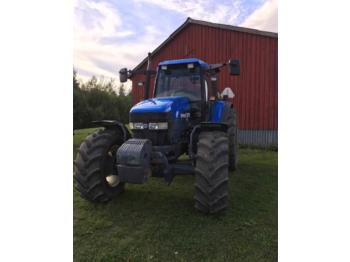 New Holland TM115  - trattore agricolo