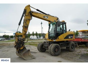 Caterpillar 313D - escavatore