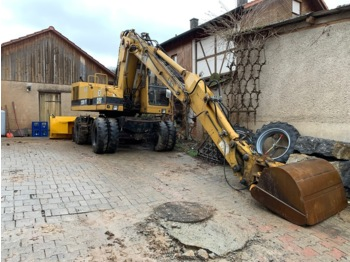 Caterpillar 212B-FT - escavatore gommato